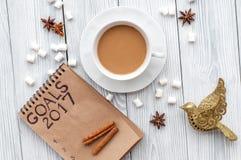 I piani per il nuovo anno in bianco aprono la vista superiore del taccuino Fotografia Stock