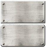 I piatti di metallo d'acciaio di lerciume hanno messo con i ribattini isolato Fotografie Stock