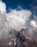 I picchi di montagna nelle nuvole, Svizzera Immagine Stock Libera da Diritti