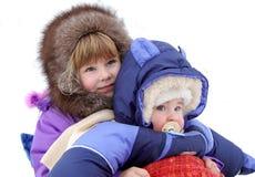 I piccoli bambini sono molto felici ad una neve Fotografia Stock