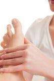 I piedi massaggiano in stazione termale Fotografia Stock