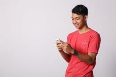 I pollici aumentano il ragazzo asiatico immagine stock