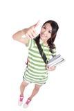 I pollici della studentessa aumentano il gesto di mano Fotografia Stock