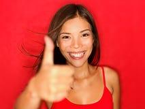 I pollici in su gradicono la donna felice Immagini Stock Libere da Diritti