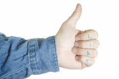 I pollici su gradiscono il gesto Fotografia Stock
