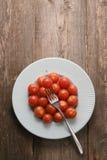 I pomodori ciliegia Immagine Stock