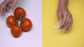 I pomodori e colpo delle pillole il macro, la dieta e la salute, geneticamente hanno modificato i prodotti archivi video