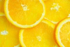 I precedenti arancio affettati immagini stock