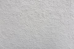 I precedenti del lavoro concreto di rifinitura di struttura bianca della parete immagine stock