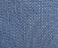 I precedenti di tessuto blu fotografia stock