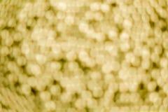 I precedenti e il bokeh vaghi palla dell'oro Fotografie Stock Libere da Diritti