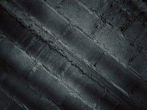I precedenti neri sono modellati dal muro di mattoni Immagini Stock Libere da Diritti