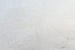 I precedenti o la struttura del hoar o la brina sul vetro di finestra fotografie stock
