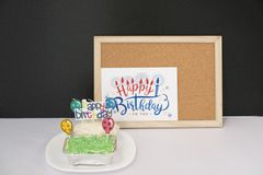 Happy Birthday with cakes on wooden frame