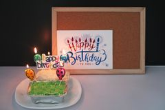 Light up Happy Birthday cakes on wooden frame