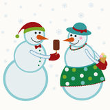 I pupazzi di neve danno i regali Fotografia Stock Libera da Diritti