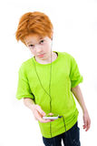 I am puzzled. Red teen listens to music. The white background isolated Stock Image