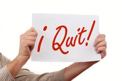 I Quit. Man is holding a piece  of  white paper, I Quit printed on the paper Royalty Free Stock Photo