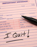 I QUIT Important Message. Pink important message pad with the words I quit written on it royalty free stock photo