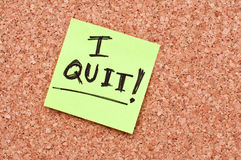 I quit note. I quit - note on a cork memory board Stock Image