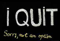 I quit sorry is not an option message. Handwriting with chalk on blackboard, lifestyle change concept Royalty Free Stock Image