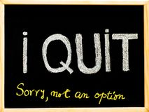 I quit sorry is not an option message, handwriting with chalk on wooden frame blackboard Stock Photography