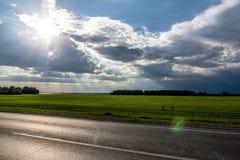 I raggi del ` s del sole da Fotografie Stock