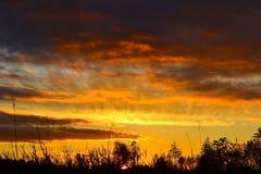 I raggi del sole al tramonto Fotografie Stock Libere da Diritti