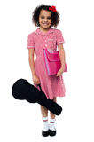 I am ready for my music class... Happy charming african kid excited to attend her first music class Stock Photo