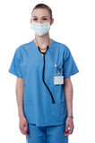 I am ready for the surgery !. Female surgeon posing with face mask Stock Photos