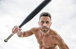 I am ready to fight. man with baseball bat. i am a criminal. Hooligan man hits the bat. Bandit gang and conflict royalty free stock images