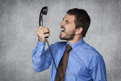 I release you by the phone. Young  business man Royalty Free Stock Photos
