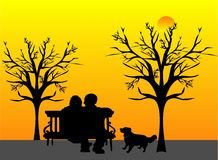 I remember when.. Loving elderly couple sitting on park bench, watching the sunset and remembering days gone by... As his best friend is leaving him soon, and Royalty Free Stock Images