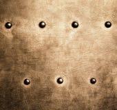 I ribattini di piastra metallica di marrone dell'oro di lerciume avvita la struttura del fondo Fotografie Stock Libere da Diritti