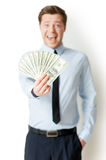 I am so rich!. Happy young man in formalwear holding money outstretched and expressing positivity while standing isolated on white royalty free stock photos