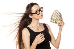 I am rich. Young girl cooling herself with a fan of money Stock Images