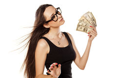 I am rich. Young girl cooling herself with a fan of money Royalty Free Stock Photo