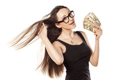I am rich. Young girl cooling herself with a fan of money Stock Image