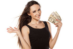 I am rich. Young girl cooling herself with a fan of money Royalty Free Stock Photos