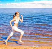 I run and it's fun!. On sky background Stock Photography
