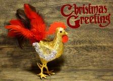 I saluti decorati di Natale del testo progettano la carta di congratulazioni dell'inverno Fotografia Stock