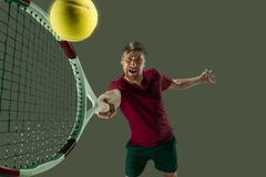 One caucasian man playing tennis player isolated on white background. I am saving this ball now. Player lunge, game of defense. The one caucasian fit man playing Royalty Free Stock Photos