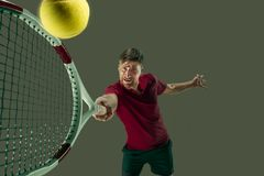 One caucasian man playing tennis player isolated on white background. I am saving this ball now. Player lunge, game of defense. The one caucasian fit man playing Royalty Free Stock Image