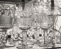 Glassware on glass shelves in glass window. I saw all of these various sizes of stemware somewhere and could not resist taking a photograph of them to show the Royalty Free Stock Photo