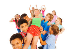 I am a school hero girl carried by others Royalty Free Stock Image