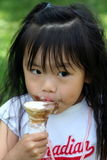 I Scream for Ice Cream. Preschooler enjoying her ice cream on a hot summer day stock photos