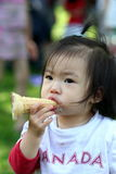 I Scream for Ice Cream. Preschooler enjoying her ice cream on a hot summer day stock photo