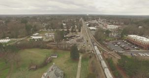 I see this train rolling along north of downtown Raleigh stock video footage