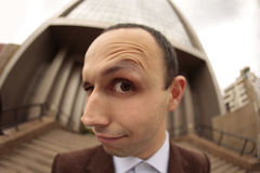 I see you. Close up with a fish eye of a man face with the eyebrow raised Stock Photography