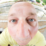 I see you. Close up with a fish eye of a man face Royalty Free Stock Images
